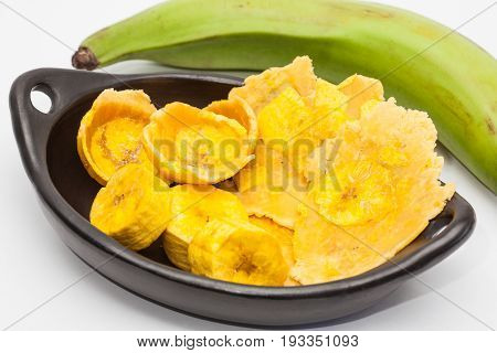Raw plantain cups, patacones and pieces on white background