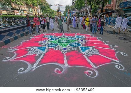 KOLKATA WEST BENGAL INDIA - JUNE 25TH 2017 : Devotees have coloured road on the eve of Rath Yatra festival. God Jagannath Balaram and Goddess Suvadra are taken outside of temples for a chariot ride in city.