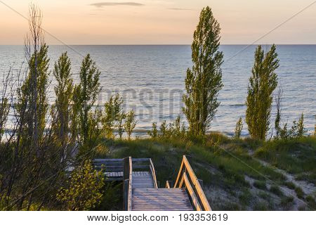 Simple Old Fashioned Wooden Boardwalk Leading To The Beach