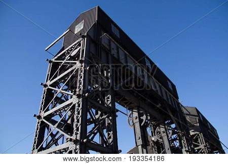 Back of iconic gantries of Gantry State Park with no cloud sky