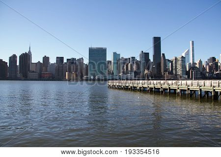 Buildings in Manhattan and East river from Gantry Plaza State Park view