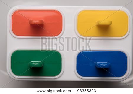 Top view closeup of ice cream lolly maker form with colorful sticks over white background