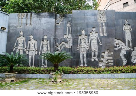 Hanoi Vietnam - Feb 20 2017 : Memorial jail interior with sculptures in Hoa Lo Prison depicting brutal treatment by French. Meditative area decorated with expressive sculptures.