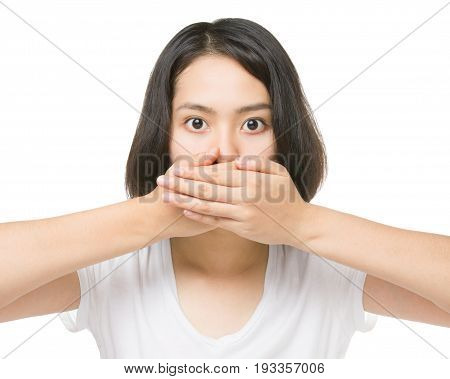 Young Asian woman closing her mouth and wide open eye isolated on white background.