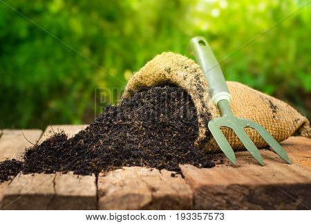 fertilizer bag over green background Summer garden concept