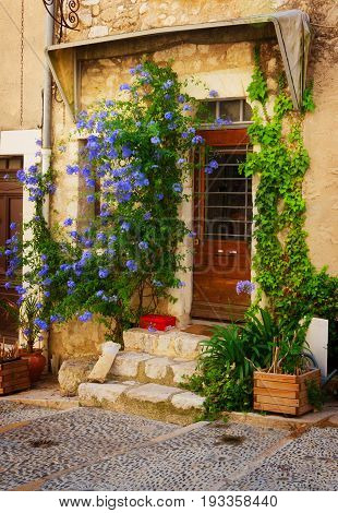 beautiful old town street with old door in Provence , France, retro toned
