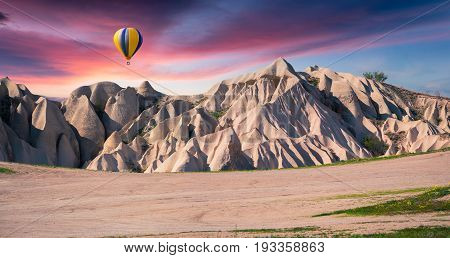 Unreal World Of Cappadocia. Sunrise In Red Rose Valley In April.