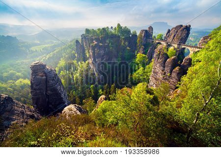 Misty Morning On Sandstone Cliff In Saxony Switzerland With Bastei Bridge