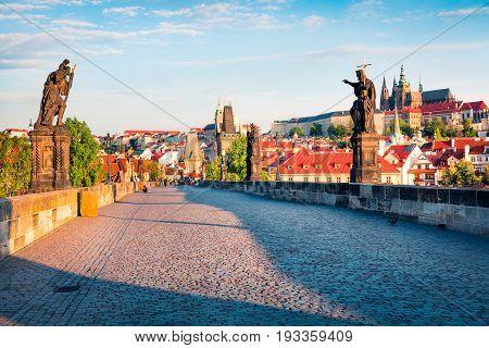 Sunny Spring Scene On Charles Bridge On Vltava River (karluv Most) With Statues And Prague Castle