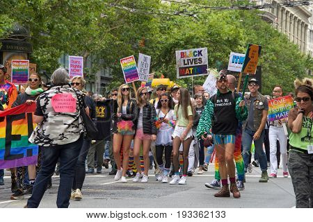 San Francisco CA - June 24 2017: Unidentified participants celebrate at the San Francisco Gay Pride Parade on Market Street downtown San Francisco. This years theme a celebration of diversity.