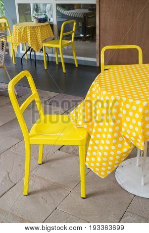 Yellow table and chair in outdoor restaurant garden stock photo