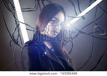 beautiful robot girl in cyberpunk style on background of wires and glowing lamps