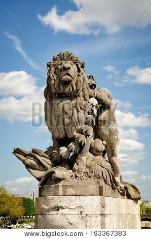 Paris France - April 18 2013:View of sculpture Lion steered by a child (Lion conduit par un enfant) at Alexander III bridge. Copy space in sky.