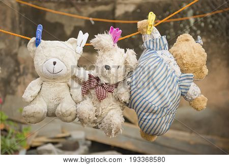 old three nurse plush toy hanging on the wire with background blur