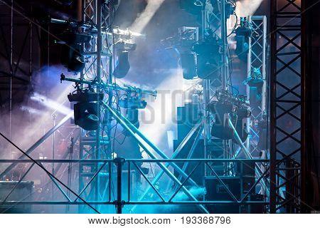 Spotlight System Illuminating Dark Stage During Performance. Equipment For Stage Lighting.