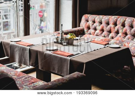 View of the served table in a restaurant. preparing for food and wine tasting. two empty wine glasse