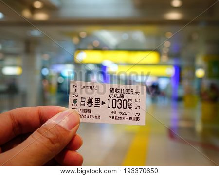 Hand Holding A Train Ticket At Station