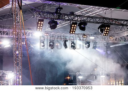 Stage Lights At Concert. Illuminated Stage With Lights And Smoke.