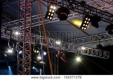 Lighting Equipment With Spotlights Under Roof Of Outdoor Stage