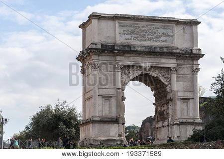 ,Tourists visiting the Arch of Titus, on December 28, 2013, in Rome, Italy