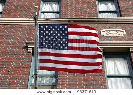Photo of the American flag background of brick wall pattern texture.