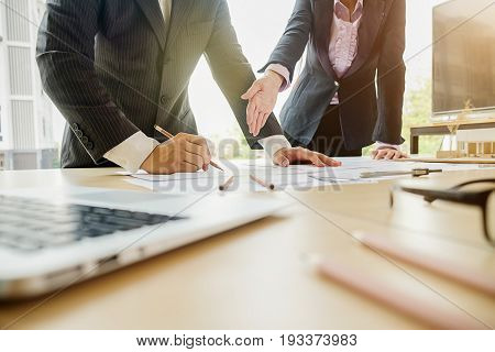 Business concept. Business people discussing the charts and graphs showing the results of their successful teamwork. Selective focus. Stock photo ID: 615570218 Signed property release on file with Shutterstock Inc. S M L Size Guide Large | 4896 px x 3264