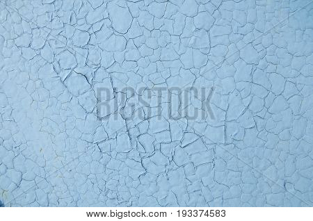 Texture of cracked colorless blue paint abstract