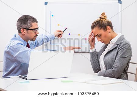 Businesswoman is getting fired by her boss.