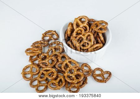 Pretzels in a White Bowl and on Whtie Counter