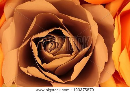 Close up of Rosy Brown or Misty Pink color rose make from paper for abstract background.