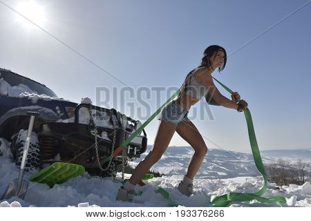 beautiful young athletic woman in winter morning