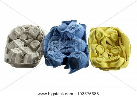 Row of Crushed Egg Cartons on White Background