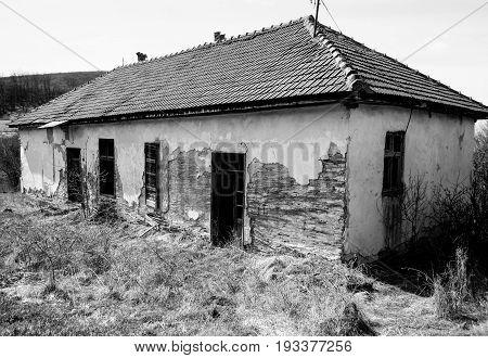 Abandoned house. Old abandoned mountain village house. Black and white. Serbia