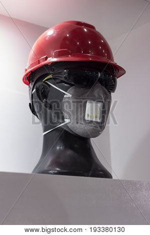 a mannequin with Safety helmets safety glasses and gas filter mask; white background; Working Hard Hat;Personel Protection Equipment PPE;clipping mask