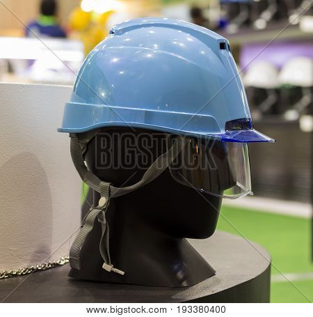 mannequins with Blue Safety helmet and safety glasses on a shelf ; Working Hard Hat;Personal Protection Equipment PPE ; side view