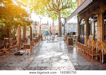 Street view with cafes near the river in the old town in Lyon city