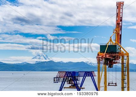 Port crane against the background of the Avacha bay