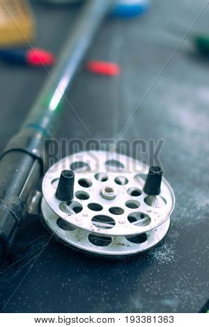 Fishing tackle on black background with blurred background