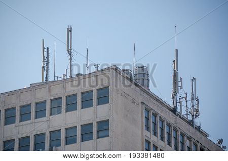 Antenna. Telecommunication antennas on the roof of the building.
