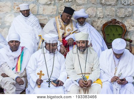 JERUSALEM - APRIL 15 : Ethiopian Orthodox worshipers waiting for the Holy fire ceremony to begin at the Ethiopian section of the Holy Sepulcher in Jerusalm Israel on April 15 2017