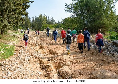 JERUSALEM - FEB. 11 2017: Group of Isaraeli fourth grade school kids and their parents on a field trip in a forest near Jerulaem