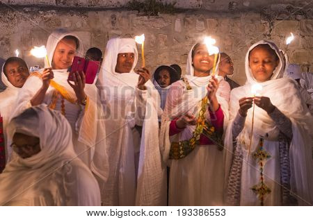 JERUSALEM - APRIL 15 : Ethiopian Orthodox pilgrims participates in the Holy fire ceremony at the Ethiopian section of the Holy Sepulcher in Jerusalm Israel on April 15 2017