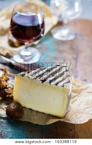 Sweet Dessert Liqueur Wine In Glass, Hard French Cheese Tomme De Montagne And Dried Figs With Figs B