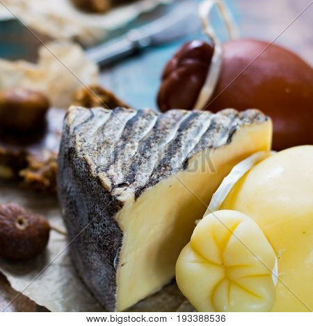 Dessert Hard Cheeses Plate -  Caciocavallo Or Provolone, Tomme De Montagne, Dried Figs With Figs Bre