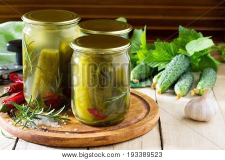 Marinated Cucumbers Gherkins. Marinated Pickles With Rosemary And Chili On The Kitchen Table.