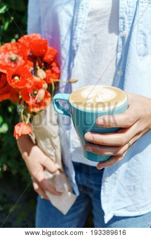 Blonde Girl Holding Poppy Flowers Bouquet And A Blue Cup Of Warm Morning Cappucino. Lifestyle Hipste
