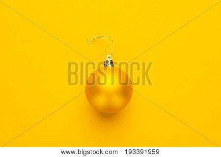 Christmas tree decoration ball. yellow decoration ball with copy space. Christmas decoration ball on yellow background. bright yellow decoration ball ready for Christmas tree