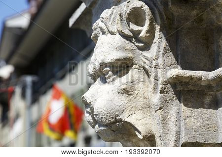 Bern Switzerland - April 20 2017: A sculpture depicting an animal face decorates a fountain in the square of the Waisenhausplatz (Orphanage Plaza). This is a detail of Waisenhausplatzbrunnen