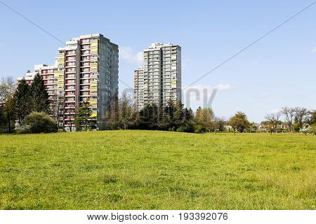 Bern Switzerland - April 14 2017: Architecture in the Murifeld district. Concrete multi-family houses dominate over the surrounding green fields