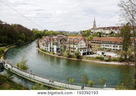 Bern Switzerland - April 17 2017: A general view towards the historic part of the city and the waters of the river Aare flowing nearby the old town